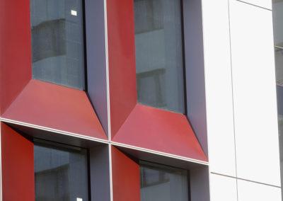 Red Building Facade Restoration After